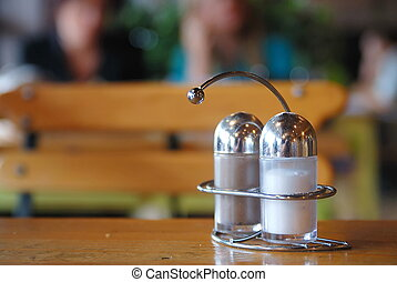 salt and paper shaker in restaurant