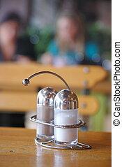 salt and paper shaker in restaurant