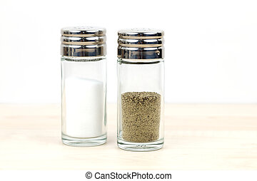 A slat and pepper shaker on a table