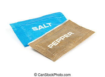 Salt and pepper sachets on a white background