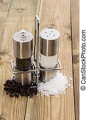 Salt- and Pepper shaker on wooden background