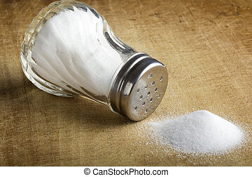 Salt cellar - Traditional glass salt cellar and spilled salt...