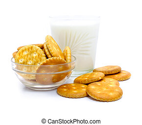 Salt crackers and milk in the glass vase isolated