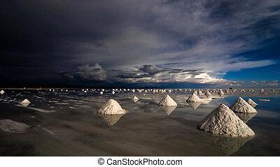 salt expoitation pyramids in salar de uyuni salt desert,...