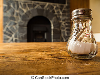 Salt in glass on the wooden