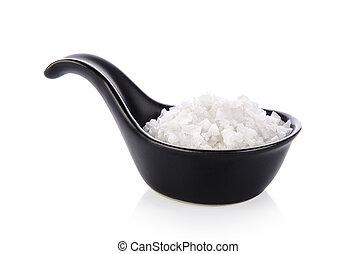 salt in spoon on white background