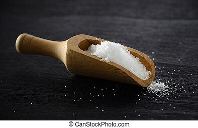 salt in wood scoop