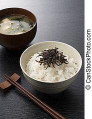 Salt kelp on top of white rice