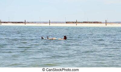 Salt Lake Baskunchak, Russia. May 11, 2013. Man swimming .