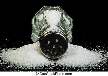 Salt on black background - Pile of spilled salt and...