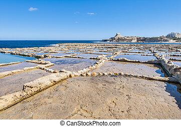 Salt pans near Qbajjar in Gozo, Malta. - Salt evaporation...
