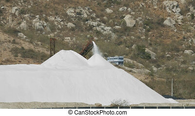 Salt Pile Poured by Modern Combine against Rocks - large...