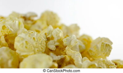Salt popcorn in box on white background, rotation, very...