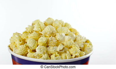 Salt popcorn in box on white background, rotation, close up...