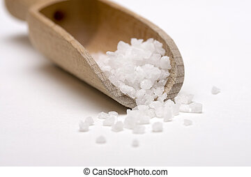 Salt scoop - Close up of salt crystals in a wooden scoop on...