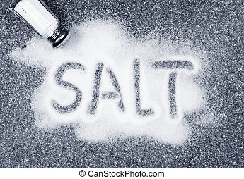 Salt spilled from shaker - Salt written on counter in...