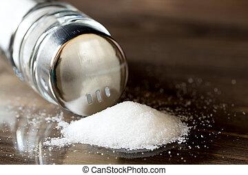 salt spilleng on a table from shaker