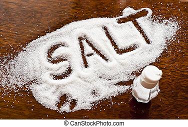 salt - Salt written on counter in spilled salts