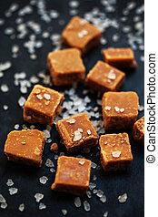 Salted caramel pieces and sea salt close up