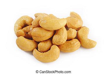 Salted cashews on white background