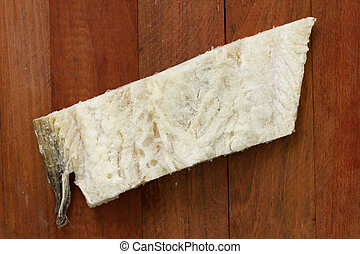salted cod fish on brown wooden background