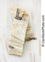 salted cod fish on white wooden background
