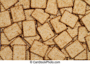 cracker  - salted cracker on the table as background