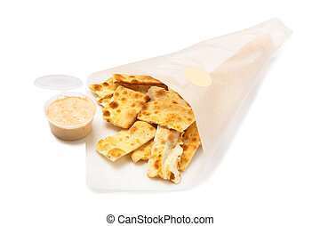 Salted crackers in a paper bag isolated on white background.