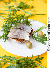 salted herring on a piece of bread, canape