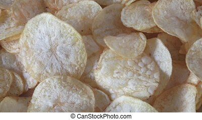 Salted potato chips on wooden background