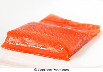 Salted salmon fillet on the white plate