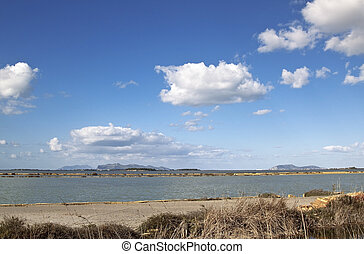 Saltern - Marsala saltern with Aegadian islands at the...