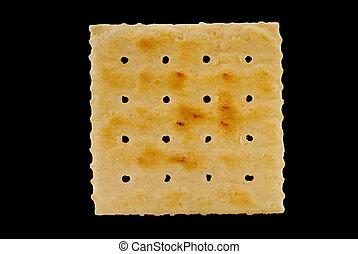 Saltine Cracker - Square saltine cracker on black with...