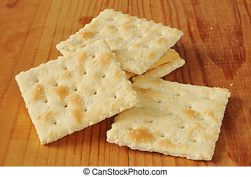 Saltine crackers on a rustic wood table