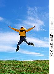 salto, prado verde, homem