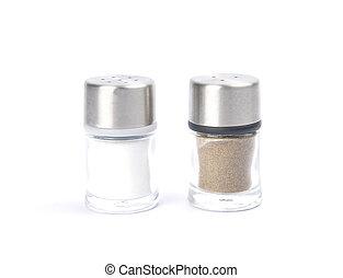 Saltshaker and pepper caster on white