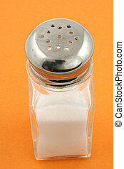 saltshaker on orange background
