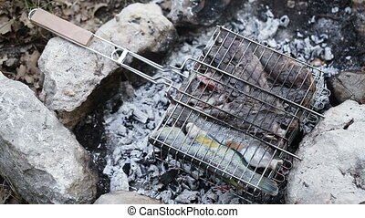 Saltwater fish on grid for barbecue