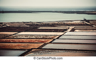 saltworks salinas de Janubio colorful on the island of...
