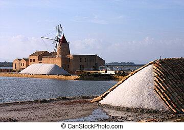 Saltworks - Old windmill in the saltworks of Marsala in...