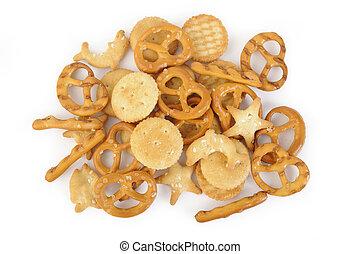 Salty cracker and pretzel on background