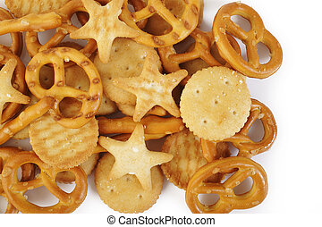 Salty cracker and pretzel on background