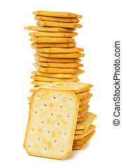 Salty cracker - Pile of salty crackers isolated on white...