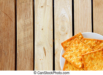 Salty Crackers are on wooden background.