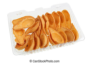 Salty little tartlets with spices in a plastic box isolated