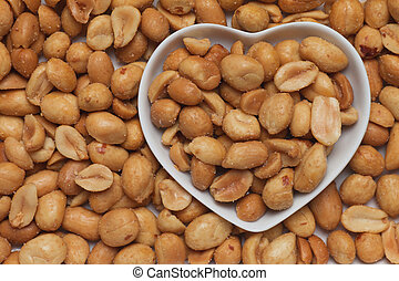Salty roasted meanuts in heart shaped tray