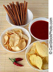 Salty snacks and salsa dip