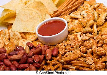 Salty snacks and salsa dip