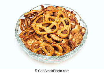 Salty snacks in glass bowl