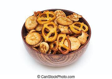 Salty snacks in wooden bowl